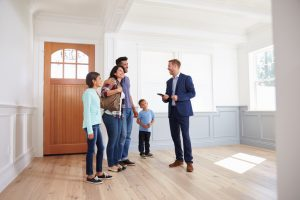 Realtor Showing Family Around New Home