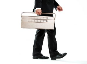 Businessman and Toolbox